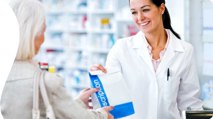 Pharmacist giving the purchased products to the customer